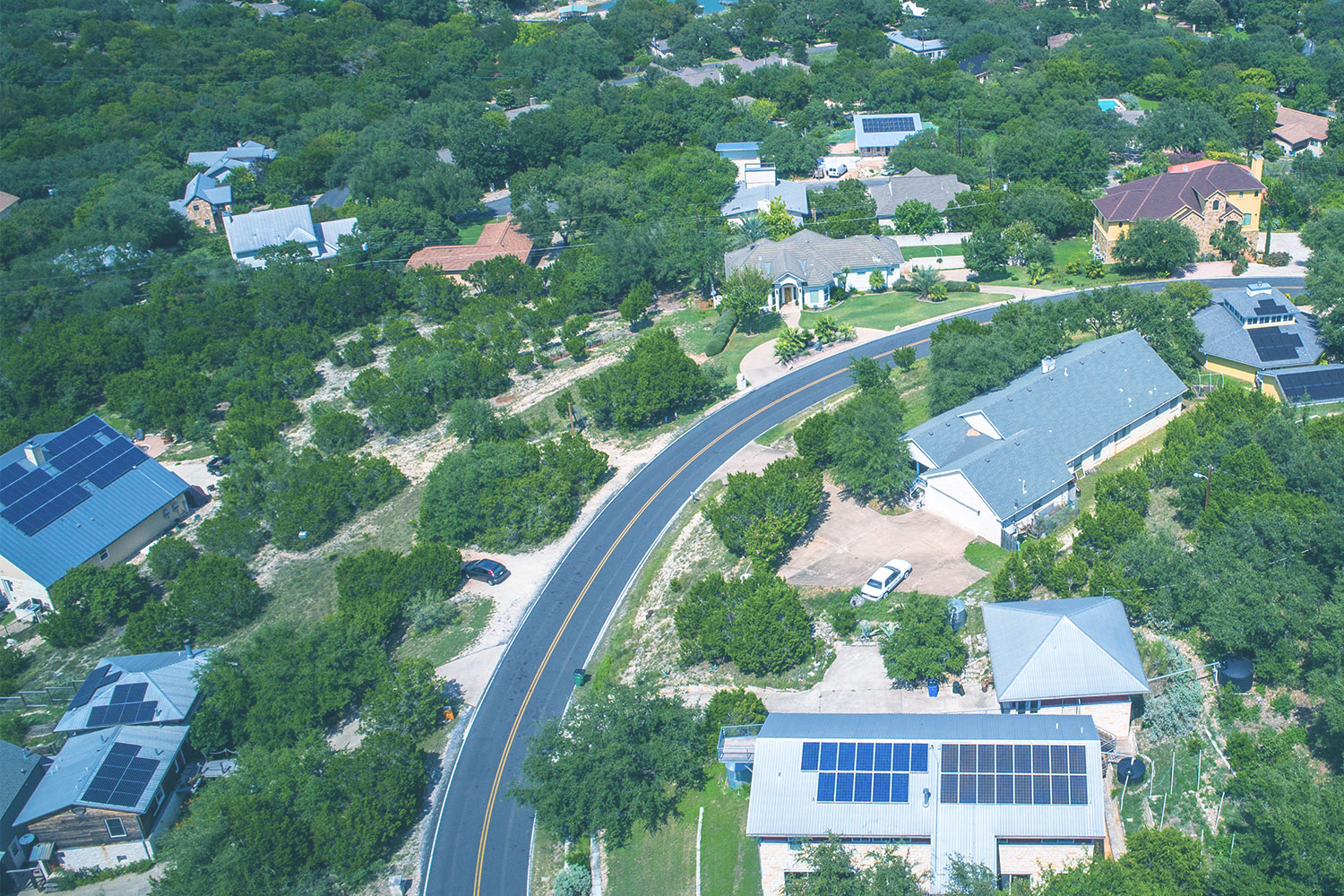Aerial view of residential houses with solar panels